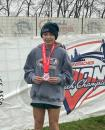 Photo provided by Art Stephenson - Mendon eighth grader Presley Allen displays the medal she earned after finishing in 16th place overall out of a field of 150 runners in Sunday's National Coaches' Youth Meet at Bourbon County Park in Paris, KY.