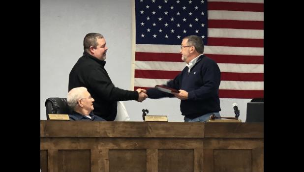 Photo courtesy Barb Kroggel - Outgoing Fabius Township Supervisor John Kroggel receives a commemorative plaque from outgoing Trustee Dan Wilkins during their meeting Wednesday, Nov. 11. Kroggel announced earlier this year he will retire after 11 years in his position.