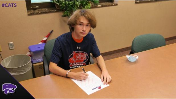 Photo provided by Matt Stofer - Three Rivers High School senior Tyler Norton signed a National Letter of Intent on Oct. 15 to run men's cross country and indoor and outdoor track for Cleary University.