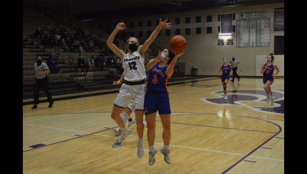 Commercial-News | Scott Hassinger - Three Rivers sophomore guard Gabby Charvat (12) defends the paint against a shot by Ella Castalucci (3) from Edwardsburg in the first half Monday.