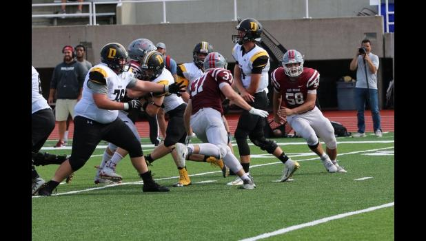 Photo provided by Rose-Hulman Athletic Department - Rose-Hulman Traven Van Oss (58) pursues at DePauw ballcarrier on an outside blitz in a 2019 game.