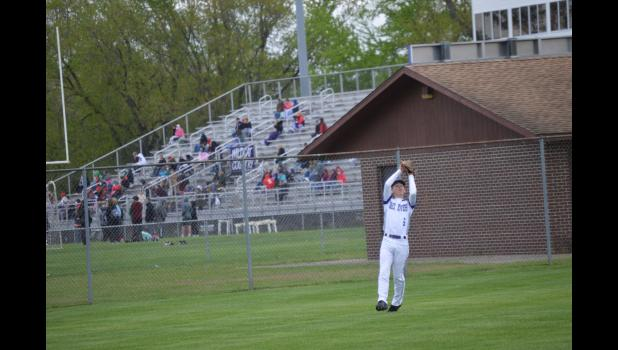 Commercial-News | Scott Hassinger - Three Rivers junior leftfielder Addison Abnet (6) hauls in a catch against Niles in the second game of Tuesday's doubleheader.