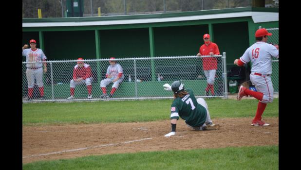 Commercial-News | Scott Hassinger - Jackson Kindig from Mendon slides safely into homeplate against Bloomingdale. Monday.