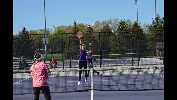 Commercial-News | Scott Hassinger - Three Rivers' Allie Lundquist prepares to execute an overhead slam for a point for her and No. 4 doubles partner Jayley Zeimet.