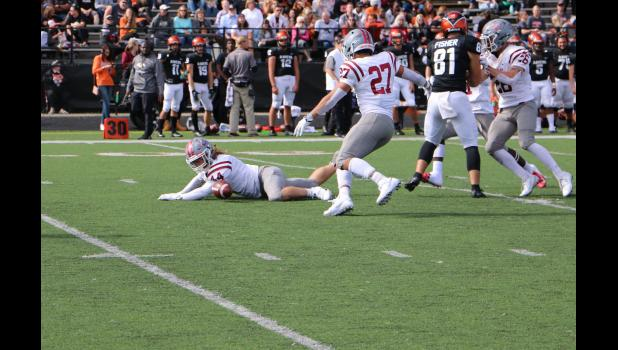 Photo provided by Kathy Wight - Centreville native Kyzer Bowen (44) helps block a punt in a 2019 football game for Rose-Hulman Institue of Technology against Anderson University.