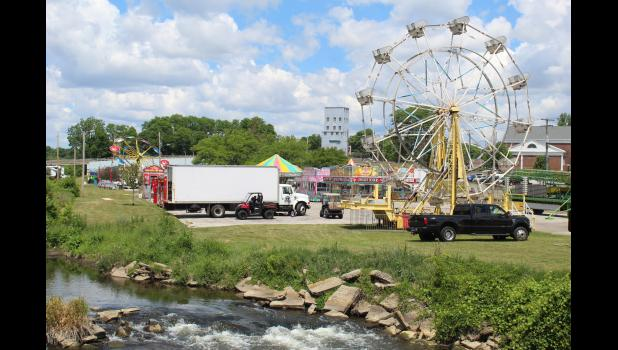 COMMERCIAL-NEWS | ROBERT TOMLINSON - A look at how setup of the Three Rivers Water Festival midway is coming along Tuesday. The 63rd festival will begin Thursday, June 17 and run through Saturday, June 19.
