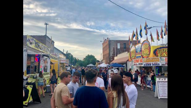 Photo provided - A group of people enjoy the midway on Kalamazoo Street during the 2019 White Pigeon Days celebration. This year's White Pigeon Days event occurs July 9 and 10, with a number of events happening, and a parade Friday at 7 p.m.