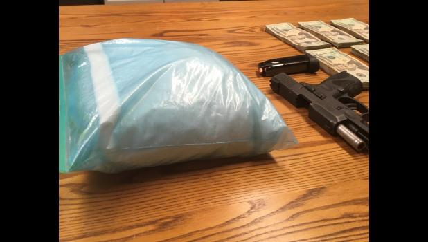 "Photo provided by Michigan State Police - More than five pounds of meth, a handgun, and a ""large amount"" of money were recovered following a drug arrest in Sherman Township Tuesday."