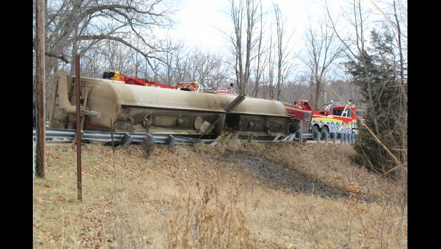 COMMERCIAL-NEWS   ROBERT TOMLINSON - A semi-truck carrying manure tipped over on Schweitzer Road just off M-60 late Wednesday morning. No one was injured in the incident.