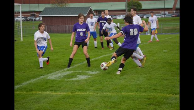 Commercial-News | Scott Hassinger - Ryan Lubieniecki (20) of Three Rivers passes the ball towards teammate Christian Selent (6) in the first half against Edwardsburg Thursday.