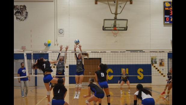 Commercial-News | Scott Hassinger - Sabrina Spence (12) from Centreville blocks a kill by a Cassopolis defender Tuesday.