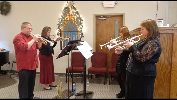Trumpet quartet A trumpet quartet of Antonia Kistler Ellis, Keith Geiman, Maggie Jonker and Beth Jonker perform at a community festival of Light and Hope on Christmas Eve at Messiah Evangelical Lutheran Church in Constantine. Photo provided by Angie Birdsall