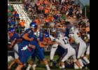 Commercial-News   Scott Hassinger - Addison Abnet (17) from Three Rivers moves in to tackle  Connor Ostrander from Edwardsburg Friday. s